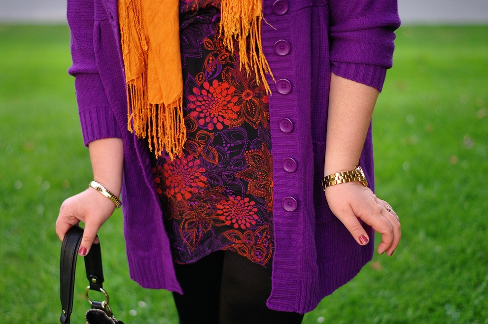 Violet cardigan and an orange scarf